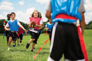 Stock photo of children playing at summer day camps